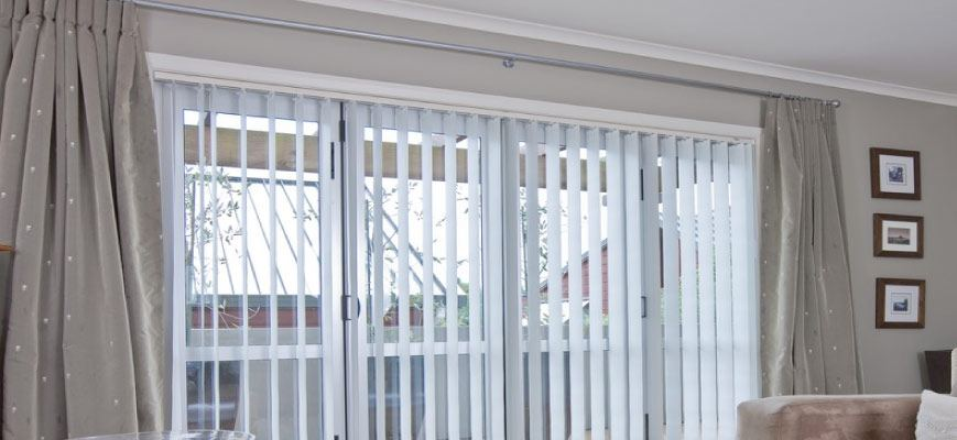 Is Installing Curtains Over Vertical Blinds A Good Idea In