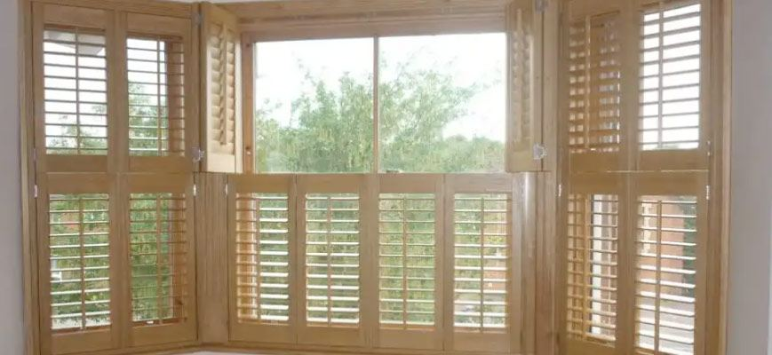 Faux Wood Shutters for Bay Windows