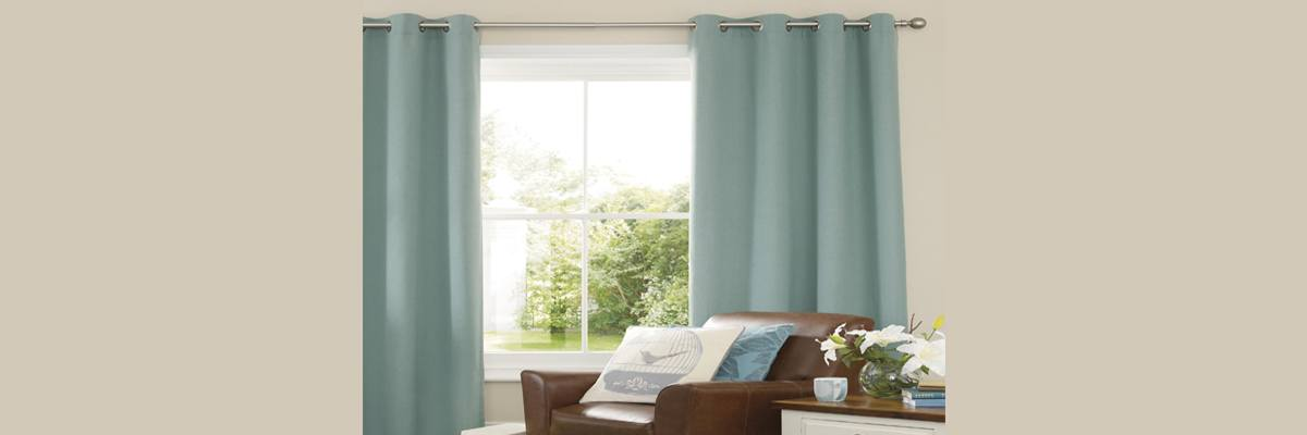 Blue Curtains with Brown Sofa